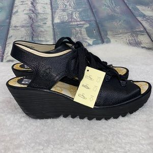 Fly London black leather Ylva lace up wedge shoes